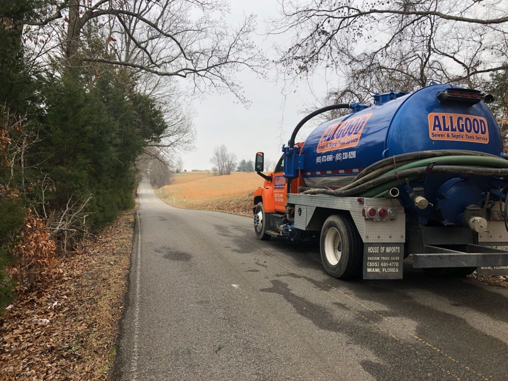 Allgood Sewer and Septic Tank Service's pump truck traveling to customer on country road to pump septic tank.