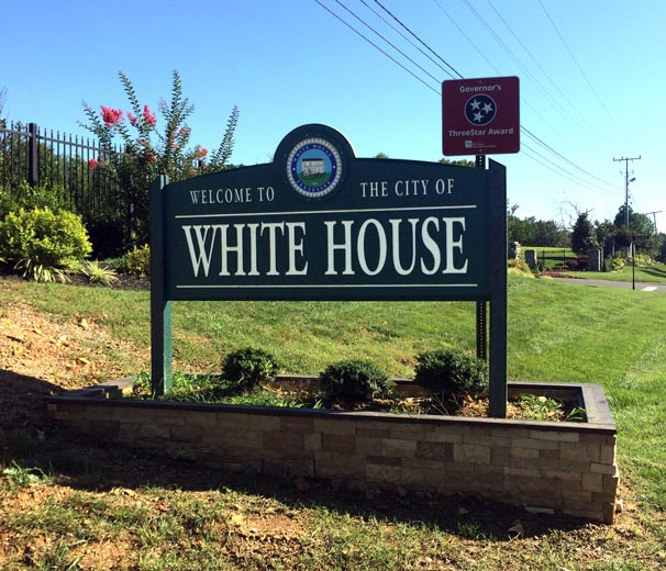 Welcome to White House sign. Allgood Septic is locally owned and operated out of White House, TN.